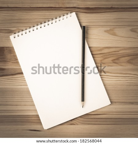 Blank Notepad on The Table - stock photo