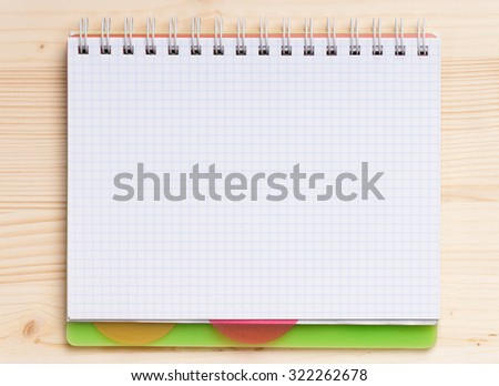 Blank notepad on the wooden table. View from above - stock photo