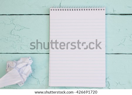 Blank notepad page and one crumpled - stock photo
