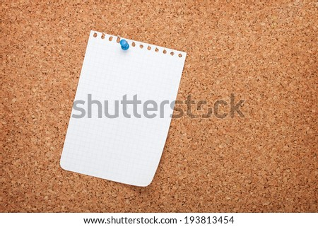 Blank notepad paper on cork wood notice board with copy space - stock photo