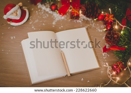 blank notepad with a pan and new year decoration