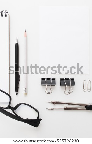 Blank Notepad With Clips, Pens And Glasses Flat Lay. Top View On Set Of
