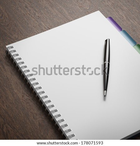 Blank notepad with pen