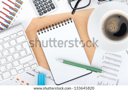 Blank notepad with pen on contemporary workplace - stock photo