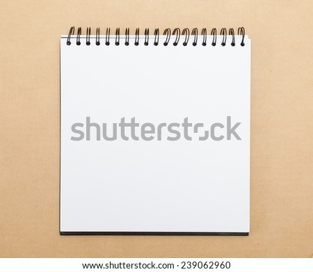 Blank notepad with pen on office  table