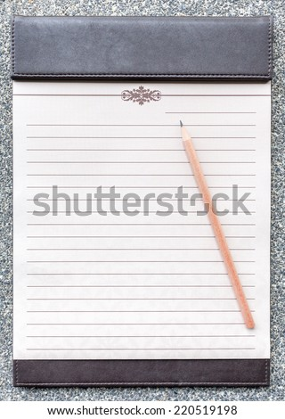 Blank notepad with pencil on the brown clipboard, for memorandum in meeting room. - stock photo