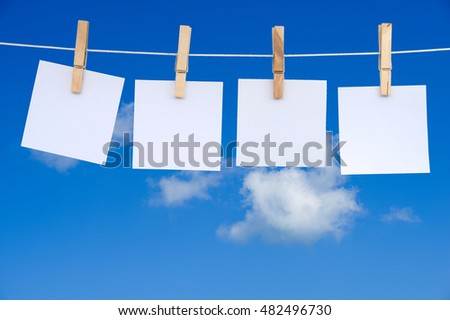 blank notes hanging on a rope with clipping path