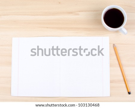 Blank notes on a desk with cup of coffee - stock photo