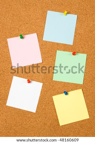 Blank notes pinned on cork notice board - stock photo