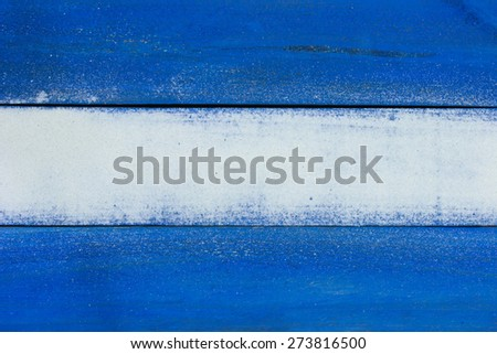 Blank ocean blue wooden beach sign with sand texture - stock photo