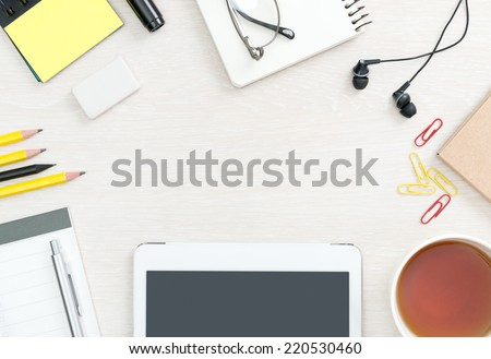 Blank office desk background with copy space for your text. Top view. Business and office supplies with modern digital tablet.  - stock photo