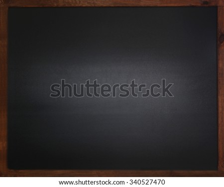 Blank old blackboard on the wall - stock photo