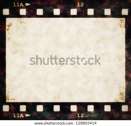 blank old grunge film strip frame background - stock photo