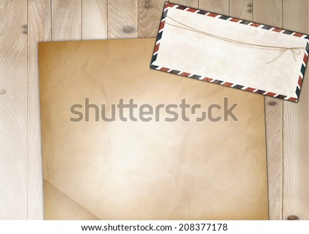 blank old nostalgic letters, post with envelope on wooden background