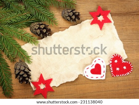 Blank Old Paper Sheet with Christmas tree branches and decorations on wooden background - stock photo