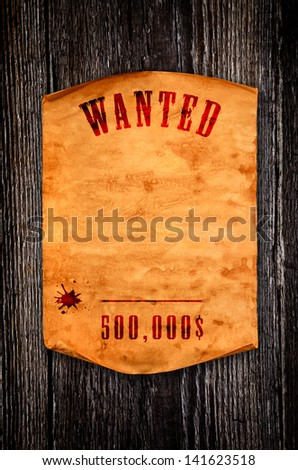 Blank old paper with curled edge against the background of an aged wood - stock photo