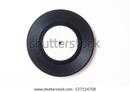 blank old phonograph disk on space of rough paper