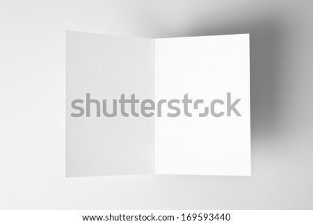 Blank open card over grey background with shadow - stock photo