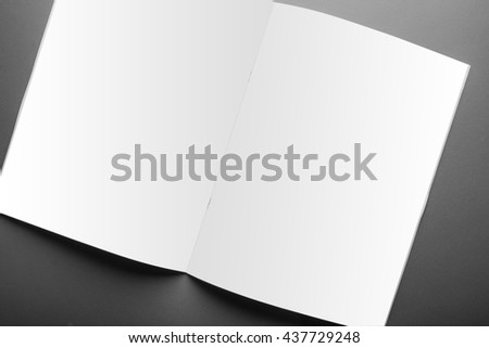 Blank open magazine template isolated on grey background with clipping path ready for your artwork - stock photo