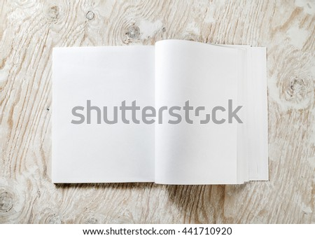 Blank opened A4 brochure magazine with soft shadows on light wooden background. Template for design portfolios. Mock-up for your design. Top view. - stock photo