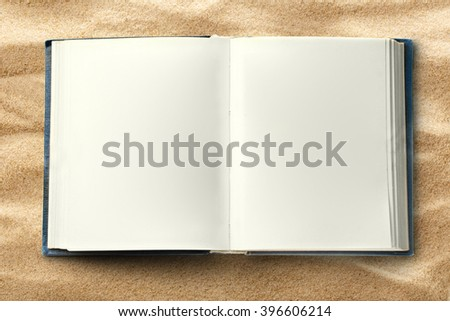 Blank opened book as background in closeup - stock photo