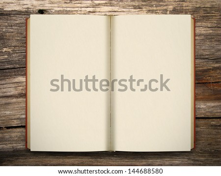 Blank opened book on wooden table - stock photo