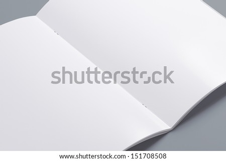 Blank opened magazine isolated on grey background with soft shadows. Closer view. - stock photo