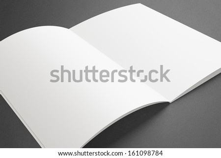 Blank opened Magazine on dark Background - stock photo