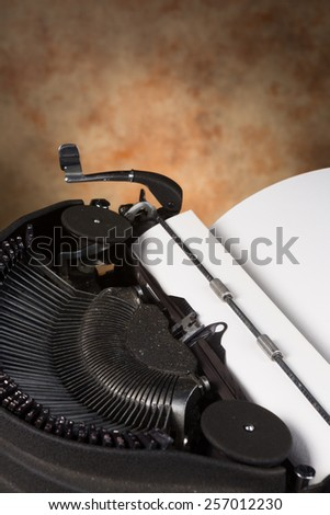 Blank page inserted in a dusty antique typewriter - stock photo