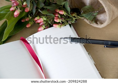 blank page notebook open with flowers background - stock photo