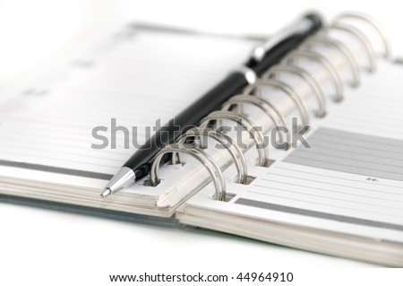 Blank page of a personal organizer and pen