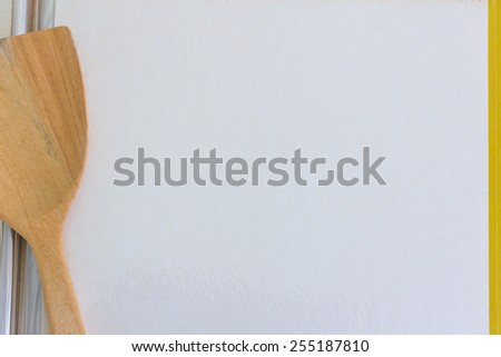 blank page of old book with ladle - stock photo