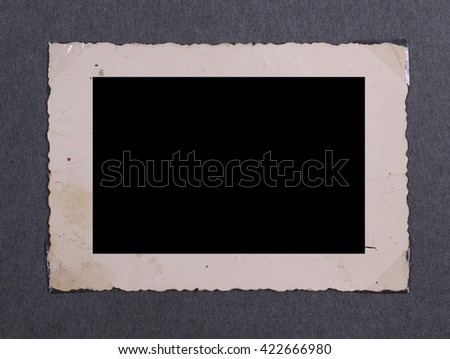 Blank page old photo album with old photo - stock photo