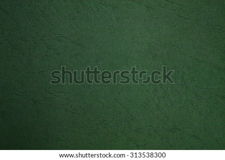 Blank page still life paper texture background with leather lines markings effect, full frame. Close up detail of textured sheet of green color organic art paper. Background rough wall emerald color. - stock photo