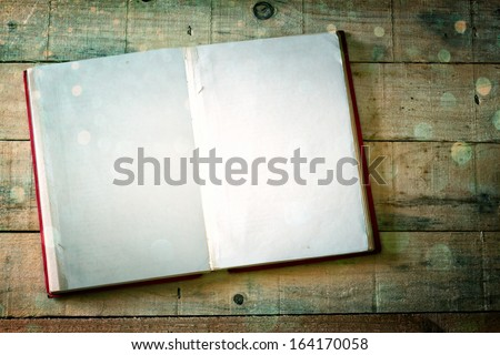 blank pages of open book over wood table. cross process effect, - stock photo