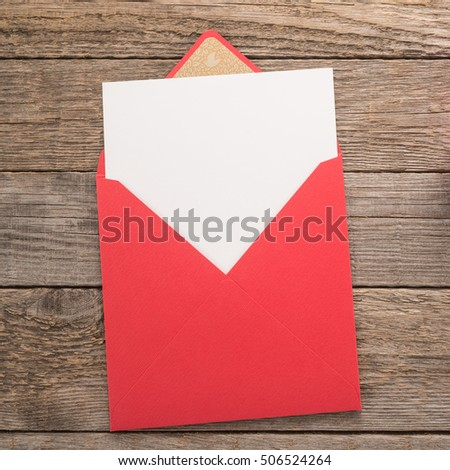 Blank paper and envelope on wooden background