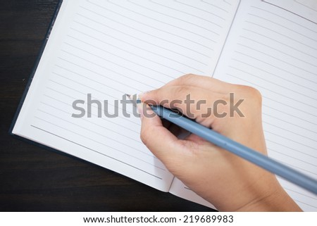 Blank paper and hand with pencil