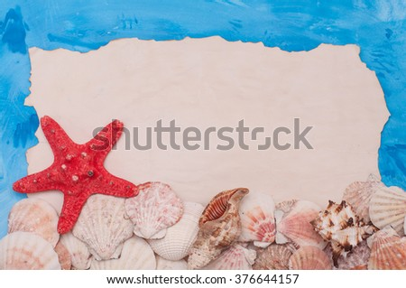 Blank paper and starfish and shells , summer concept