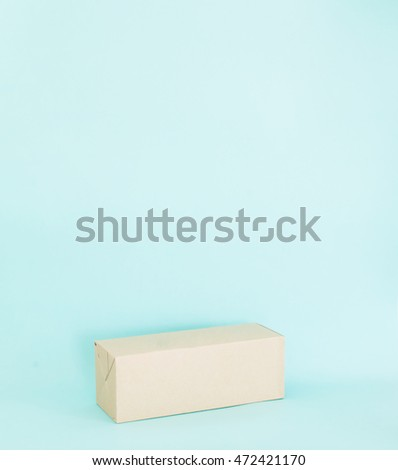 Blank paper box on soft blue background.