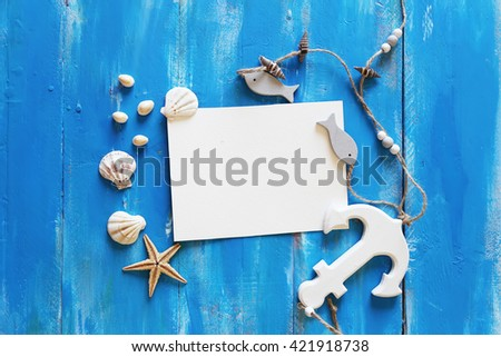 Blank paper card and seashells on wooden background - stock photo