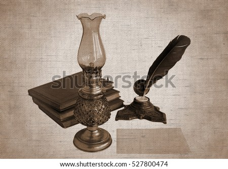 Blank paper card, oil lamp and inkwell with a quill pen. Photos with the effect of natural canvas in sepia tone.