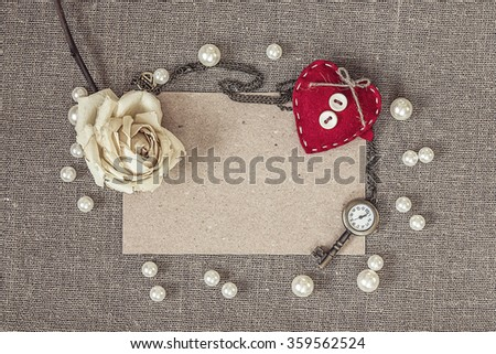 blank paper card with heart, rose, pearls and watches as a key, valentines day card concept.
