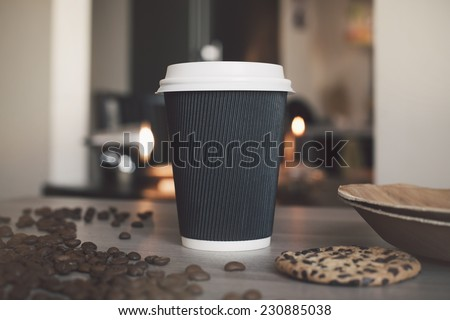 Blank paper cup of coffee in a coffee shop for the application logo - stock photo