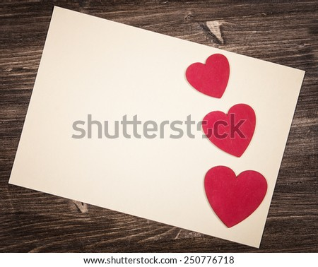 Blank paper decorated with hearts