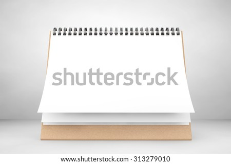 Blank paper desk spiral calendar on the white background - stock photo