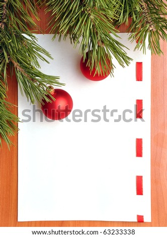 blank paper for messages and christmas ornaments - stock photo