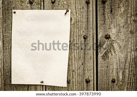 blank paper for note posted on wood background with vintage look - stock photo