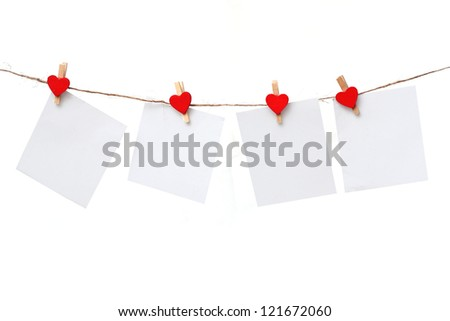 blank paper  hanging on the clothesline. - stock photo