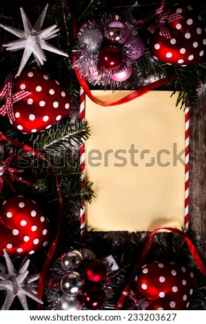 Blank paper in the middle of Christmas decorations on wooden background