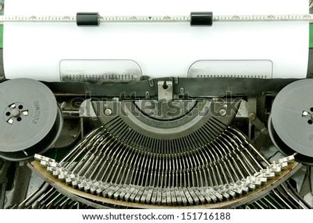Blank paper in typewriter - stock photo